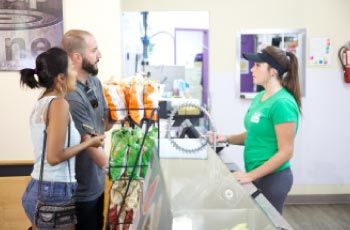 Customers at the counter of a Wrapzone